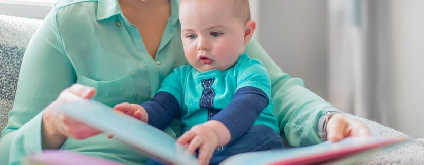 baby reading with mother
