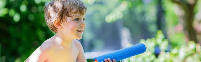 kid-playing-with-a-water-gun