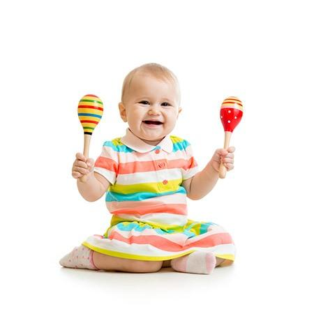 baby girl with rattles