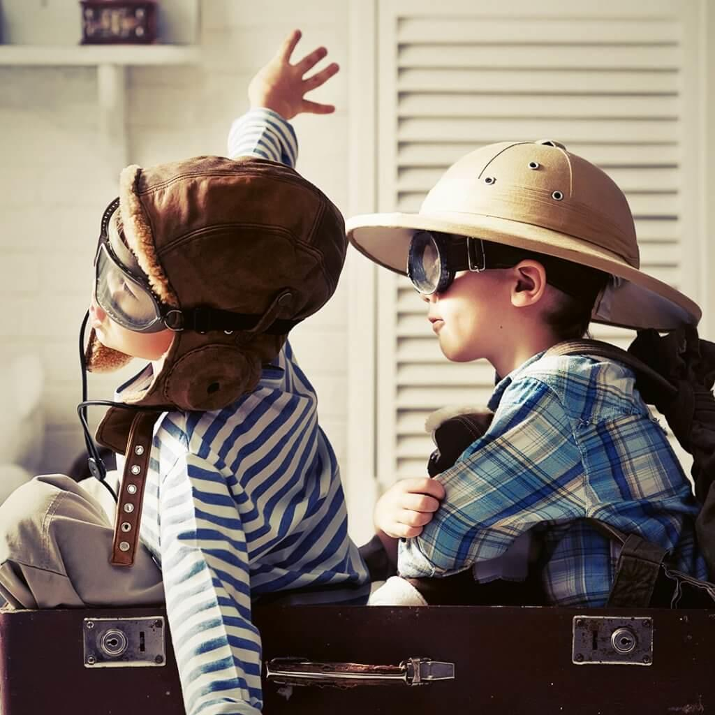 Kid-On-Suitcase-Traveling-With-Kids-Blog-Page