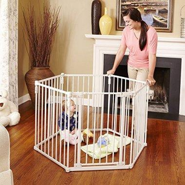 A mother uses the metal gate to safely contain her child during playtime.