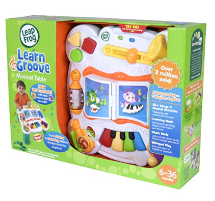 LeapFrog Learn & Groove Musical Table packaging features a variety of instruments.