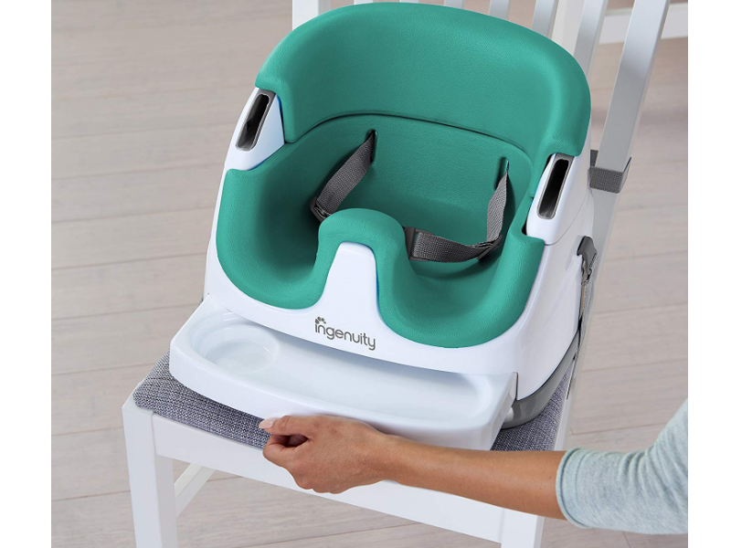 The Ingenuity Baby Base features a feeding tray