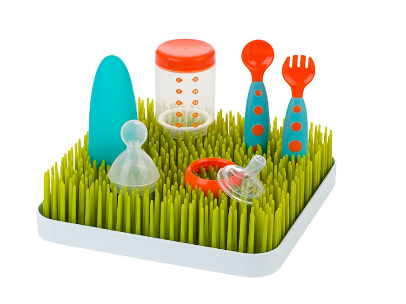 The Boon Green Grass Countertop Drying Rack features a bottom tray.