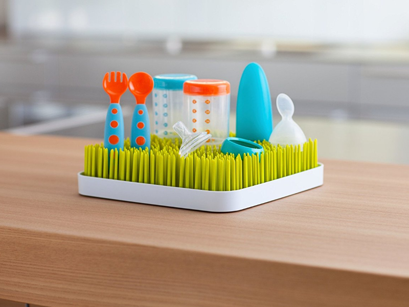 The Boon Green Grass Countertop Drying Rack is an easily portable item.