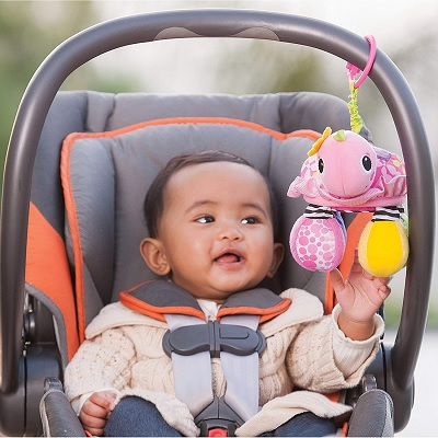 Infantino Sparkle Topsy Turtle car seat toy hanging display