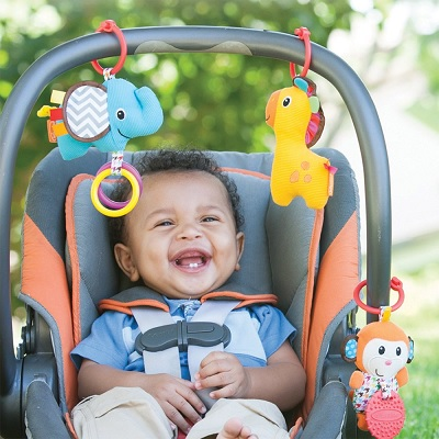 Infantino Tag Along Travel car seat toy baby smile
