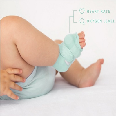 Owlet Smart Sock 2 Heart Rate Baby Breathing Monitor attaches to the baby's foot