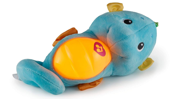 The Fisher-Price Soothe & Glow Seahorse is a popular choice for a crib toy.