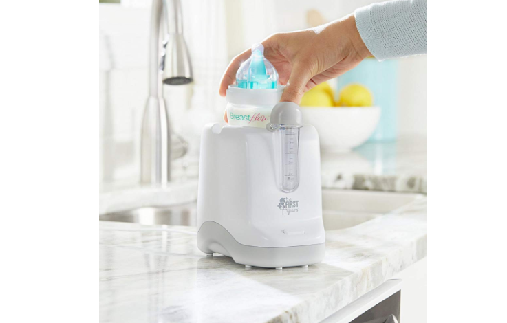 The First Years bottle warmer is versatile and comes with a pacifier sanitizer feature.