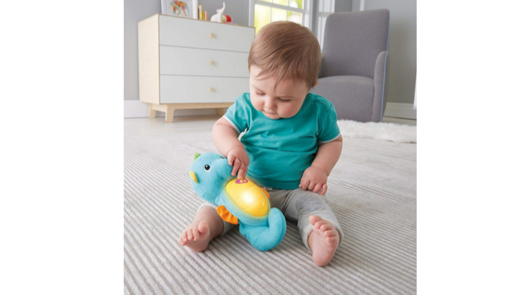 The Fisher-Price Soothe & Glow Seahorse has a glow in the dark tummy.