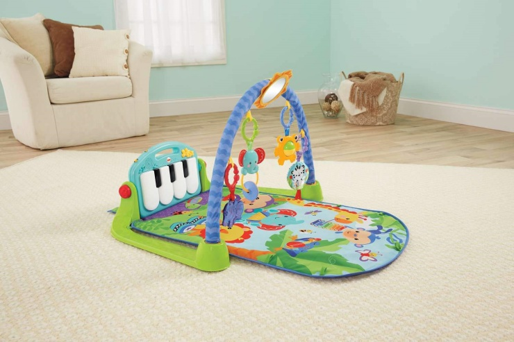 The Fisher-Price Kick 'n Play Piano Gym features five busy activity toys.