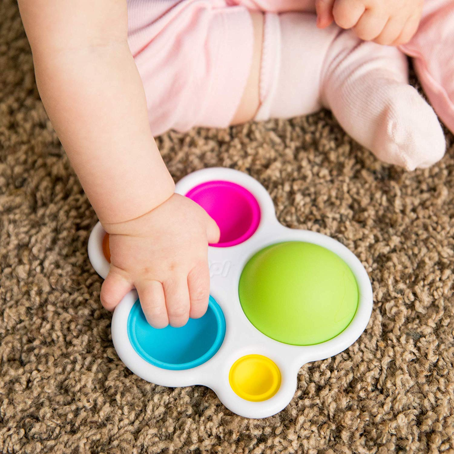 Dimpl is perfect for the little fingers to poke the silicone bubbles.