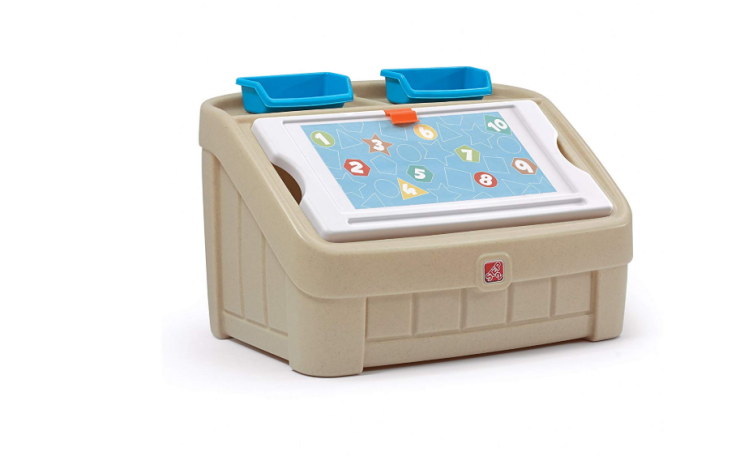 The Step2 2-in-1 Toy Box and Art Lid includes 2 supply containers.