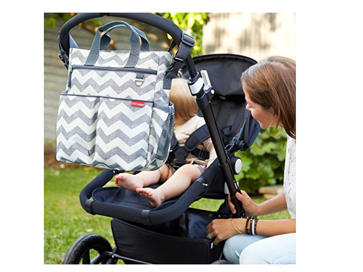 The Skip Hop Duo Diaper Bag can be attached to a stroller.