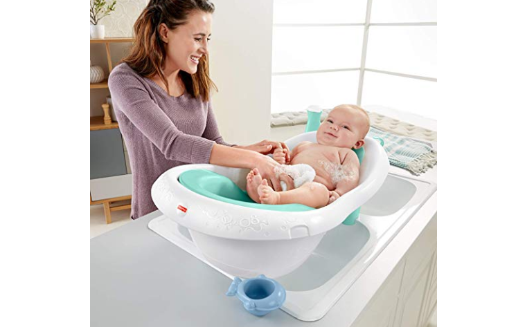 The Fisher-Price 4-in-1 Sling 'n Seat Tub will make bath time fun for the baby.