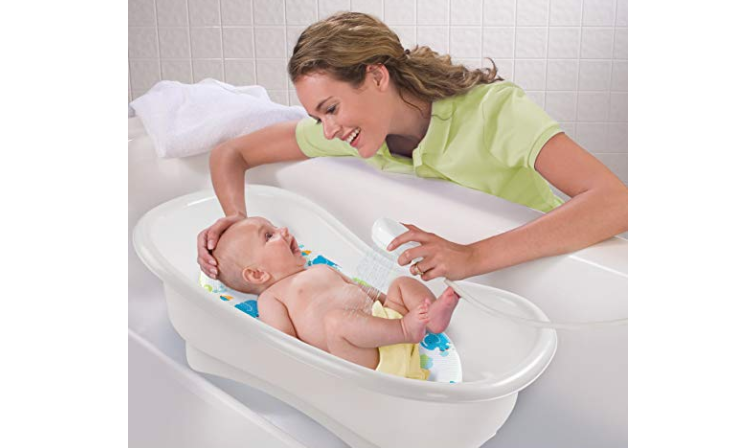 The Summer Infant Newborn to Toddler Bath Center and Shower features an ergonomic shaped handle.
