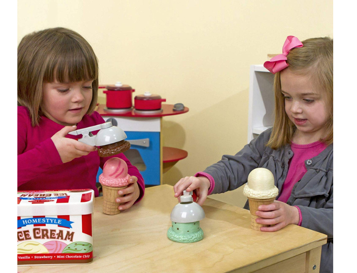 The Melissa & Doug Scoop & Stack Ice Cream Play Set incourages social interaction.