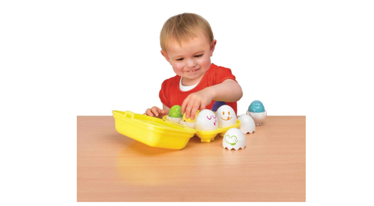 The TOMY Toomies Hide & Squeak Eggs can help kids learn shapes.