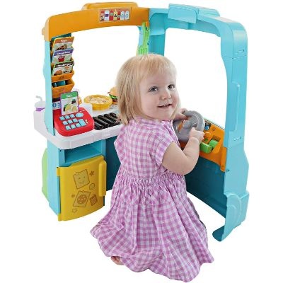 fisher-price servin' up food truck play kitchen for kids and toddlers kid playing