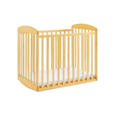 davinci alpha mini rocking natural portable cribs right side