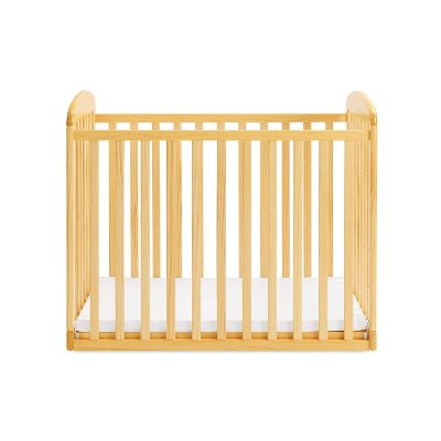 davinci alpha mini rocking natural portable cribs front