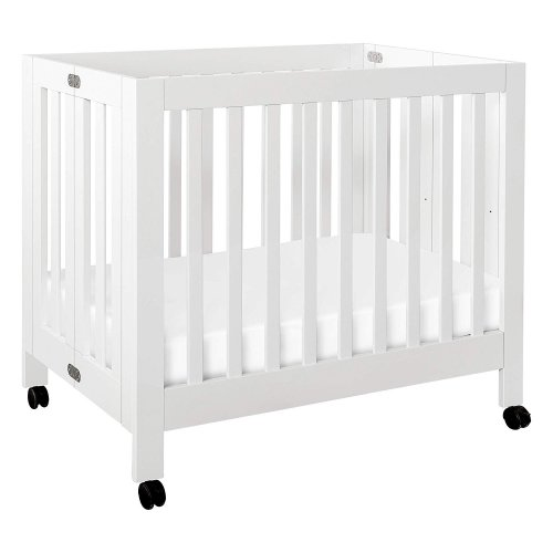 babyletto origami mini with wheels portable cribs front side