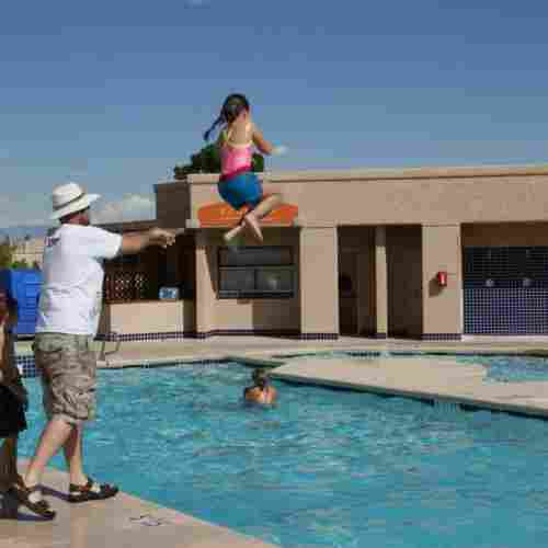 Father-Throwing-Kid-in-Pool-kids-swimming-blog-post
