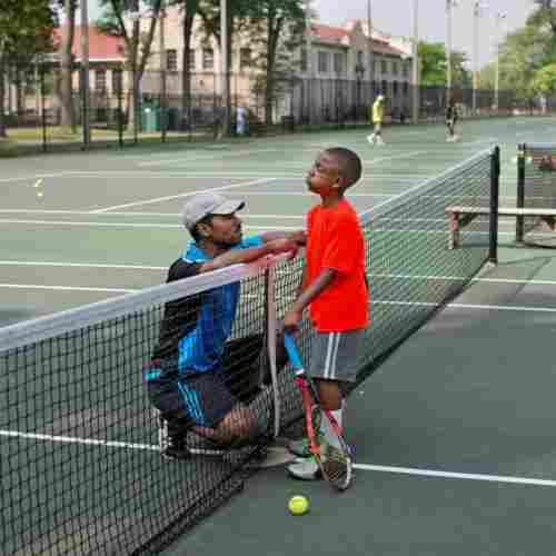 Kid-Playing-Tennis-Best-Team-Sports-Blog-Page