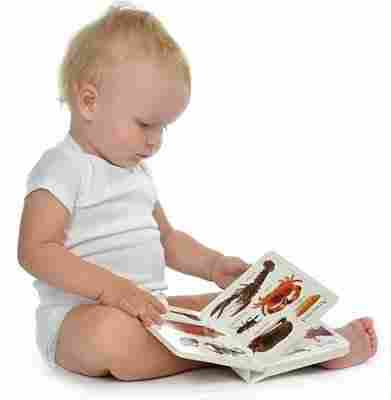 baby reading book and learning